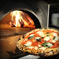 Fresh Double Zero Flour Neapolitan Pizza coming out of brick oven